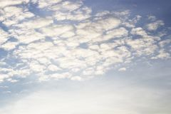Bright blue sky with white clouds stock photography