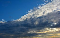 Bright blue sky with white clouds in sunset, Norfolk, United Kingdom. Bright blue sky with white cumulus clouds in sunset, Norfolk, United Kingdom royalty free stock image