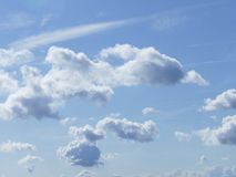 Clouds in formation. Bright blue sky with white fluffy clouds Stock Images