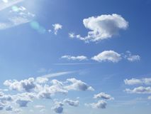 Clouds in formation. Bright blue sky with white fluffy clouds Stock Photography