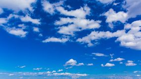 Bright blue sky with white varied clouds stock image