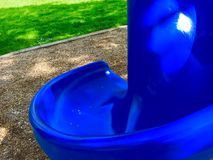 Bright Blue Slide. Bright blue playground slide in a park Stock Photos