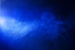 Bright Blue Smoke on Black Background. Texture background of blue hazy smoke stock photography