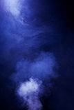 Bright Blue Smoke on Black Background. Texture background of blue/purple hazy smoke royalty free stock images