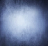 Bright blue smoke over black background Royalty Free Stock Images