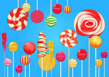 Bright blue sugar background with bright colorful lollipops candy sweets. Candy shop. Sweet color lollipop.  Royalty Free Stock Photography