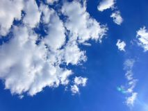 Bright Blue Summer Sky. With white, fluffy clouds stock photo