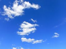 Bright Blue Summer Sky. With white, fluffy clouds stock photography