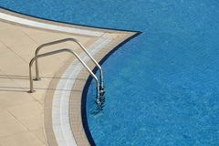 Bright blue swimming pool Stock Images