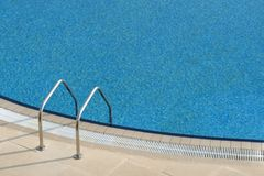 Bright blue swimming pool Stock Photo