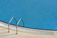 Bright blue swimming pool Stock Photo