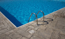 Bright blue swimming pool. Railing of the clean shiny swimming pool outdoors Royalty Free Stock Photos