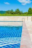 Bright blue swimming pool outdoors