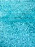 Bright blue textured background, well visible texture, there are several bands, similar to the texture of Terry towels. Bright blue textured background, well royalty free stock images