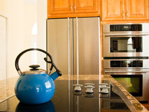Bright Blue Traditional Kettle. Bright Blue Traditional Whistling Kettle in Modern American Kitchen Stock Images