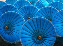 Bright blue umbrellas in the province of chiang mai in Thailand. Decorative Arts Royalty Free Stock Photo