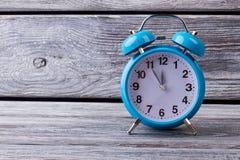 Bright blue vintage alarm clock. Royalty Free Stock Image