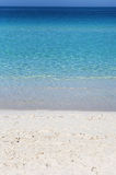The bright blue water of the calm ocean Stock Photos
