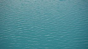 Bright blue water surface. Closeup stock video footage