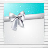 Bright blue and white card with silver ribbon Royalty Free Stock Photo