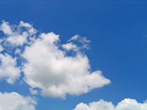 Bright blue and white clouds. Corner of blue sky among clouds Royalty Free Stock Photography