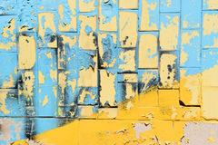 Bright blue and yellow tiles from Ukraine. Magnification of wall with tiles on a sunny day. Stock Photo