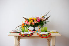 Bright boho flowers on the served table Royalty Free Stock Photography