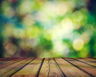 Bright Bokeh And Wooden Floor Stock Photography