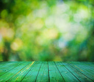 Bright bokeh and wooden floor Stock Photos