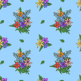 Bright bouquet of flowers on a blue background. Seamless pattern Royalty Free Stock Photos