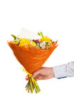 A bright bouquet of flowers with a congratulatory card. With a male hand Stock Photography