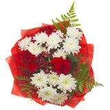 Bright bouquet on a white background. Beautiful summer flowers bouquet of red roses and white chrysanthemum and green fern leaves in red wrapping paper isolated Stock Images