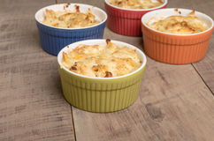Bright bowls of baked macaroni and cheese Stock Images