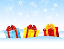 Bright boxes with gifts on to snow Royalty Free Stock Photos