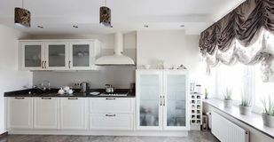 Bright brand new european kitchen Stock Images