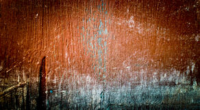 Bright brown background with dark corners. The texture of the old painted plywoo. D Stock Images