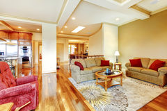 Bright brown and red living room interior with hardwood floor, n Stock Photo