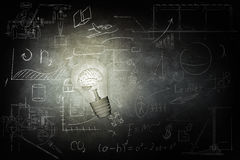 Bright bulb Illuminates icons on chalkboard. Bulb Illuminates mathematics and business icons on the school chalk board. 3d illustration Royalty Free Stock Image