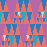 Bright bunting style pink and blue triangle design on coral colour background. Seamless vector pattern with hot fiesta stock photography