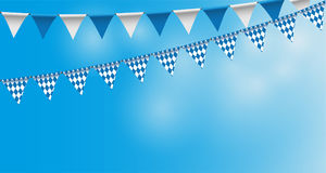 Bright buntings garlands with rhombus pattern, bunting festoon, background, Decorated in traditional colors of Bavaria Royalty Free Stock Photo
