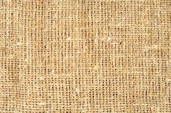 Bright burlap golden sacking background Stock Photography