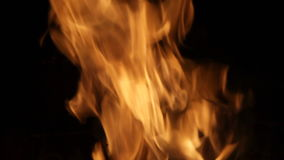 Bright a burning flame. Of fire against a dark background stock footage