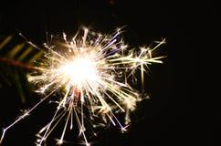 Bright burning sparkler on christmas Stock Photo