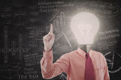 Bright businessman and blackboard Royalty Free Stock Images