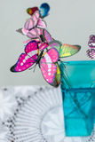 Bright butterflies. Bright butterflies in a vase Royalty Free Stock Images