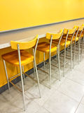 Bright cafeteria with a raw of chairs Stock Photography
