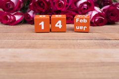 Bright calendar February 14 and roses. Colored card for Valentine`s Day. Calendar with festive date and roses stock images