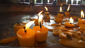 Bright praying Candle light in a temple Royalty Free Stock Photo