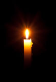 Bright candle with rays Royalty Free Stock Images