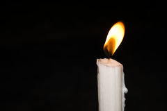 Bright candlelight in the darkness Stock Images
